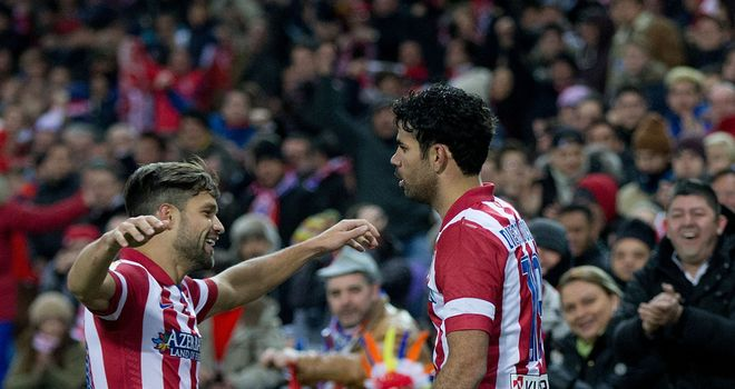 Diego Costa of Atletico de Madrid celebrates scoring their second goal with Diego Ribas