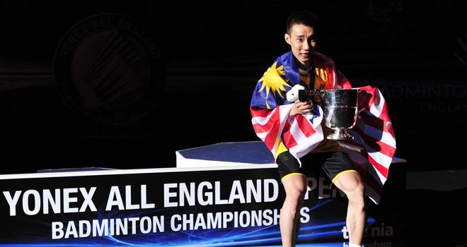Lee Chong Wei of Malaysia poses with his All England Open trophy