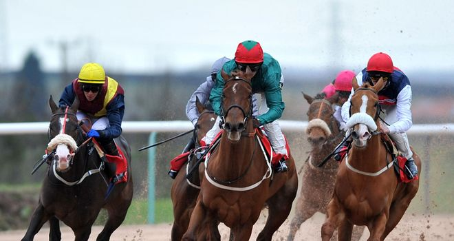 Cloverdale ridden by Joe Fanning (centre) leads On Demand at Southwell