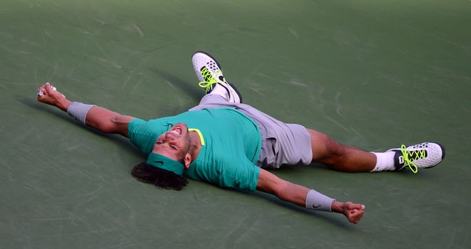 Rafael Nadal of Spain drops to the ground defeating Juan Martin Del Potro last year