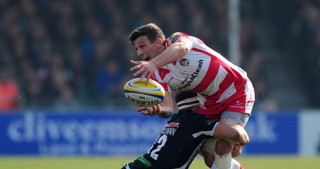 Gloucester's Ryan Mills gets a pass away under pressure
