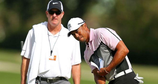 Tiger Woods practices at Doral as caddie Joe LaCava watches on