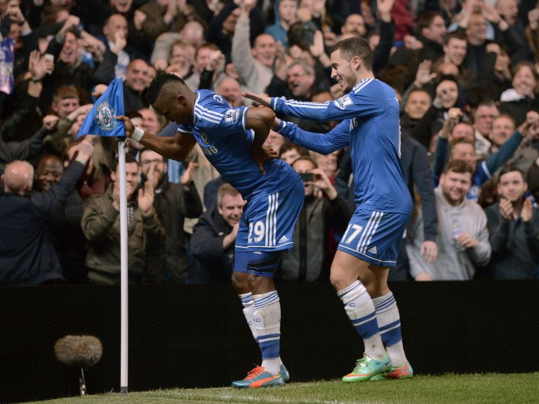 Samuel Eto' o celebrates by posing like an old man