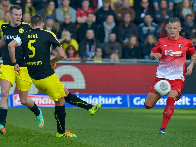 Dortmund's midfielder Sebastian Kehl scores