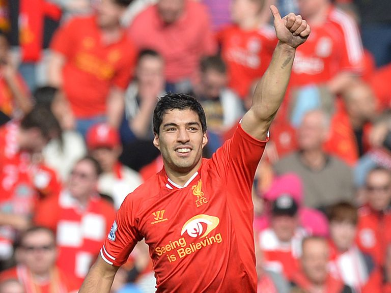 Luis Suarez celebrates after finding the target at Anfield