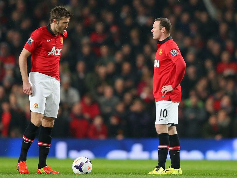 Wayne Rooney (r) and Michael Carrick are left dejected at Old Trafford