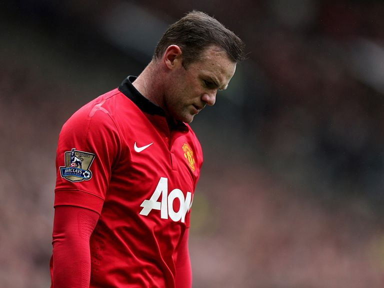 A dejected Wayne Rooney sums up the current mood at Old Trafford