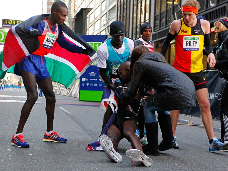 Mo Farah collapses after crossing the line in New York