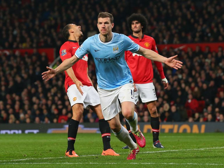 Edin Dzeko celebrates scoring his and City's second goal at Old Trafford