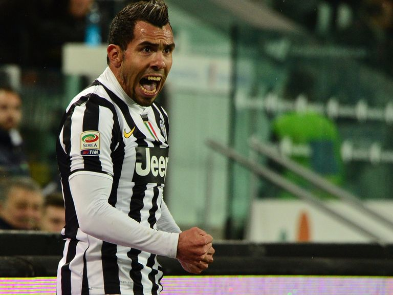 Juventus foward Carlos Tevez celebrates after scoring