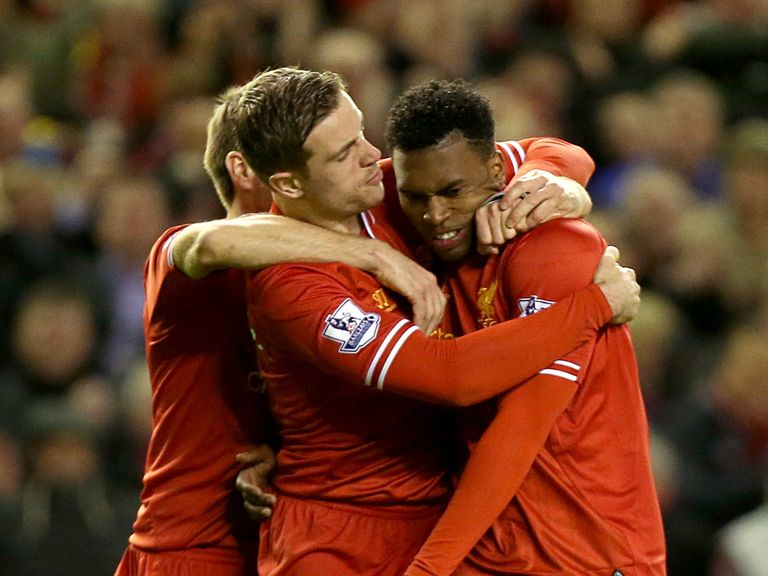 Daniel Sturridge celebrates with team-mate Jordan Henderson