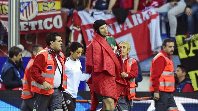 Petr Cech: Chelsea goalkeeper is helped off against Atletico Madrid