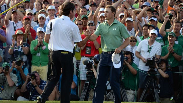Bubba Watson and Jordan Spieth (r) shake hands following Sunday's final round