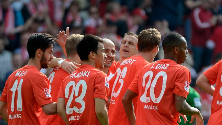 Mainz celebrate after an early own goal from Nils Petersen