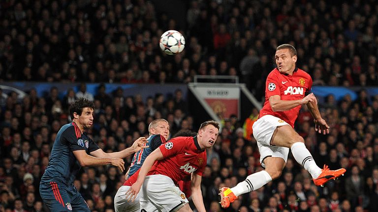 Phil Jones watches on as Vidic heads goalwards in a Champions League tie against Bayern Munich