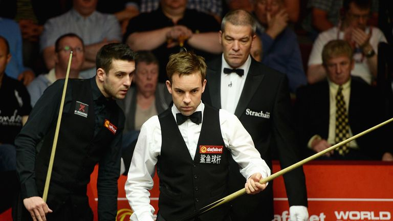 Ali Carter (right) playing Mark Selby at the World Championship last month