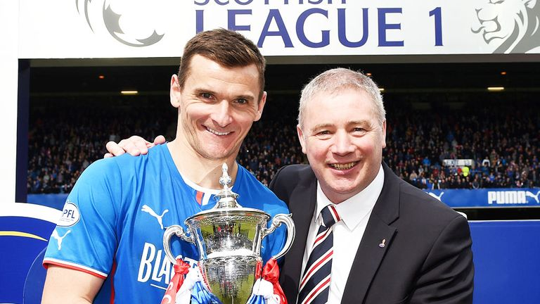 Rangers skipper Lee McCulloch and manager Ally McCoist celebrate winning League One championship last season.