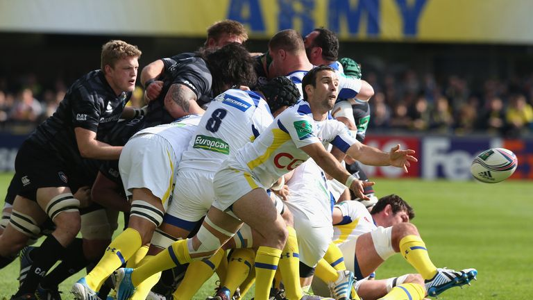 Clermont's Morgan Parra spins out a pass