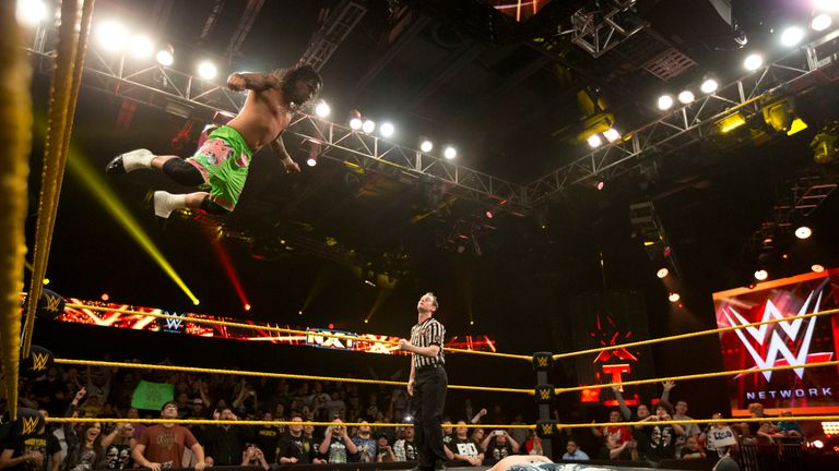 Jey Uso leaps onto the stricken Corey Graves