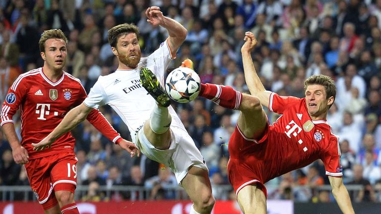 Xabi Alonso (left): Will miss the Champions League final