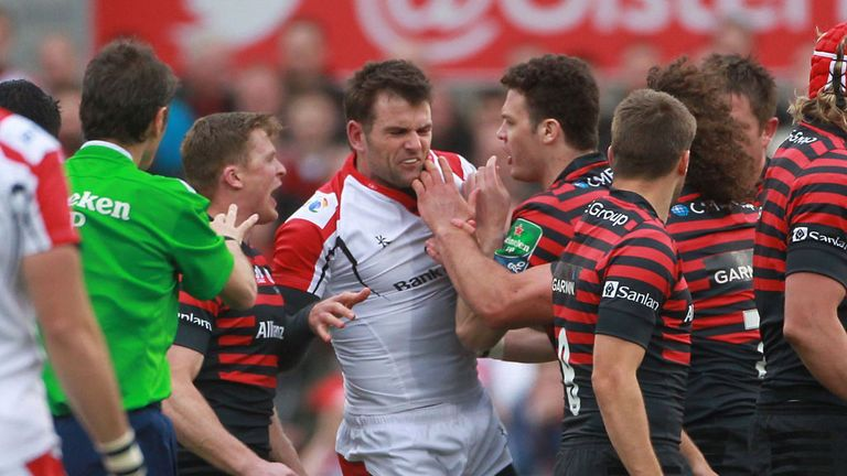 Saracens players confront Jared Payne after his challenge on Alex Goode