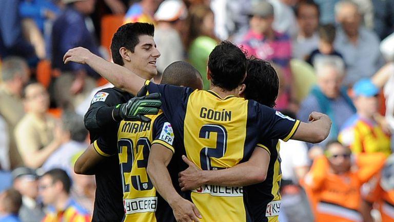 Atletico Madrid celebrate Raul Garcia's winner against Valencia