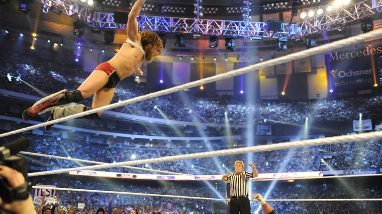 Bryan leaps onto Triple H at WrestleMania 30