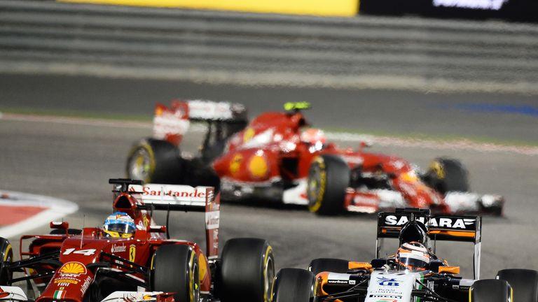 Nico Hulkenberg passes Fernando Alonso