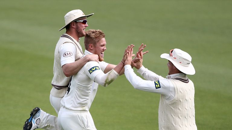 Surrey's Matt Dunn celebrates the wicket of Essex opener Alastair Cook