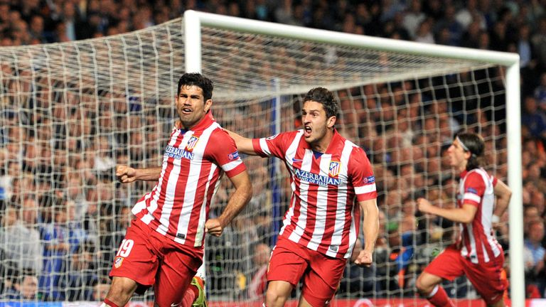Diego Costa celebrates firing home a second-half penalty to put Atletico Madrid ahead