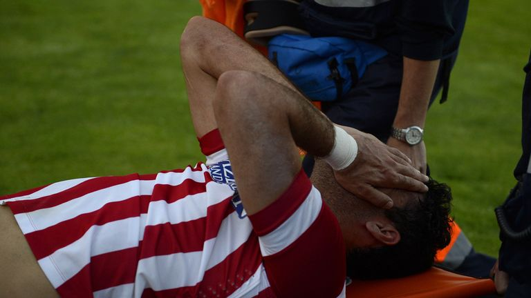 Diego Costa: Stretchered off after injuring his left leg