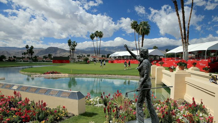 Players on the 18th green behind the statue of Dinah Shore who originated the event in 1972