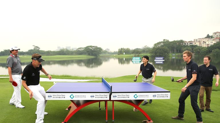 Ian Poulter in action during a table tennis match at the Opening Ceremony