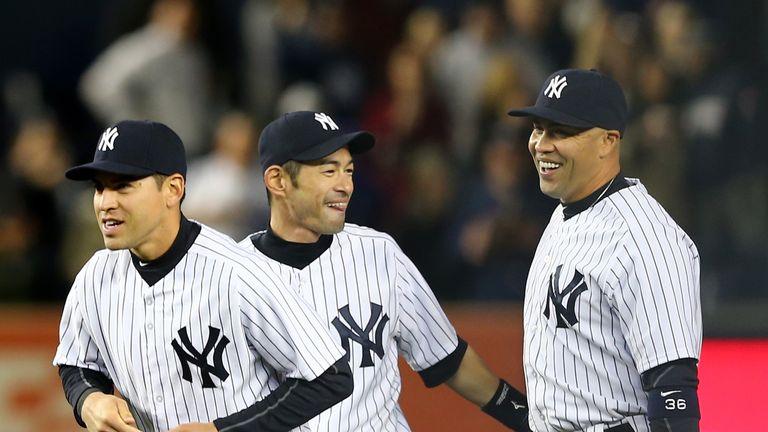 Jacoby Ellsbury,Ichiro Suzuki and Carlos Beltran of the New York Yankees celebrate