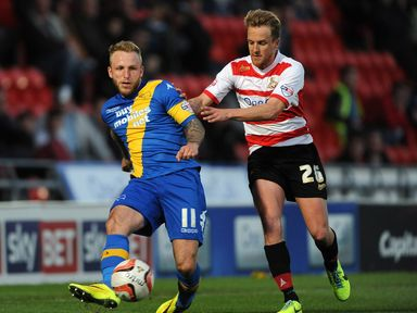 Johnny Russell and James Coppinger battle for the ball
