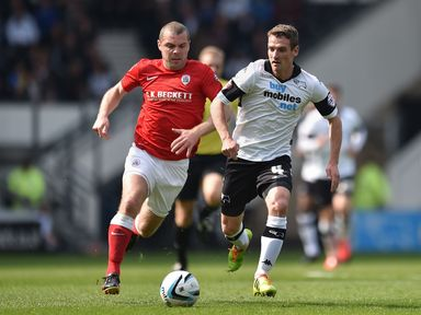 Derby County's Craig Bryson gets away from Barnsley's Stephen Dawson