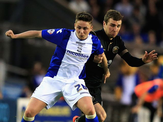 Scott Allan of Birmingham battles with James McArthur of Wigan