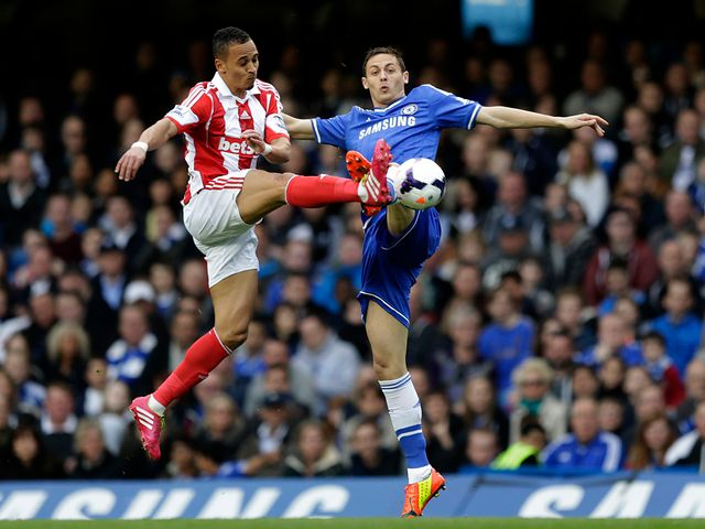 Nemanja Matic tries to stop Peter Odemwingie