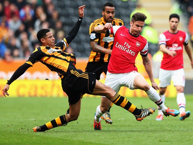 Curtis Davies of Hull City tackles Arsenal's Olivier Giroud