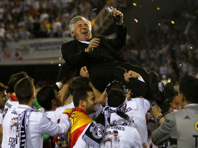 Carlo Ancelotti is thrown into the air in celebration