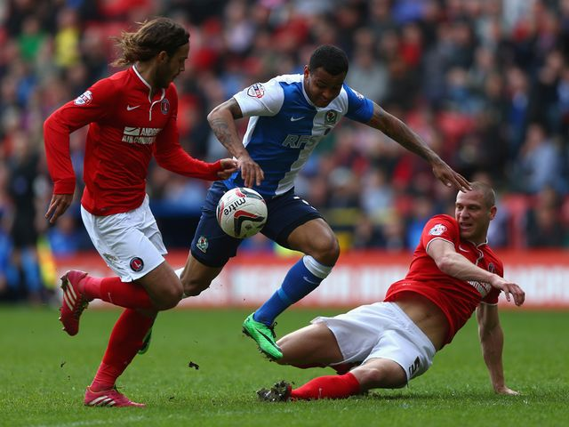 Joshua King of Blackburn Rovers is challenged Diego Poyet (L) and Michael Morrison (R) of Charlton