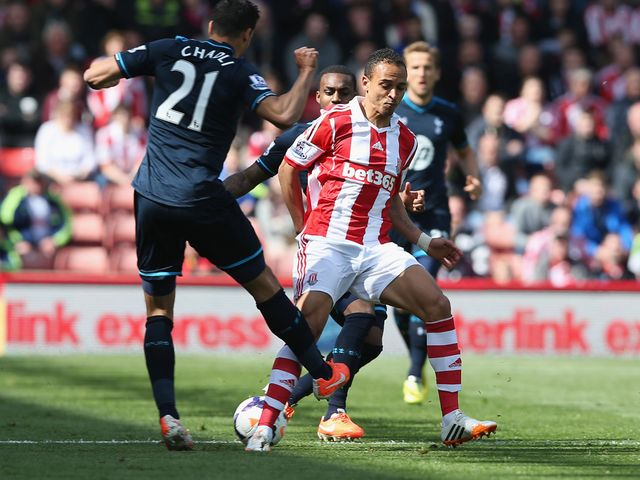 Peter Odemwingie of Stoke in action with Nacer Chadli of Tottenham