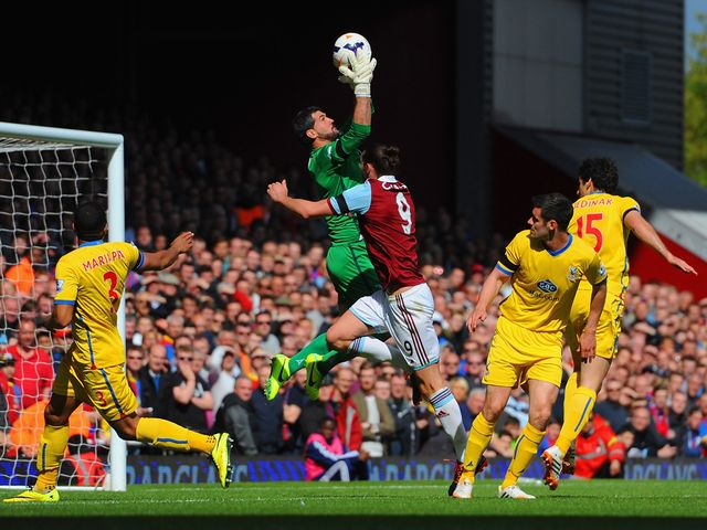 Julian Speroni e makes a save from Andy Carroll