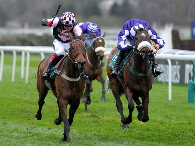 Avispa (left) ridden by Robert Thornton wins at Aintree
