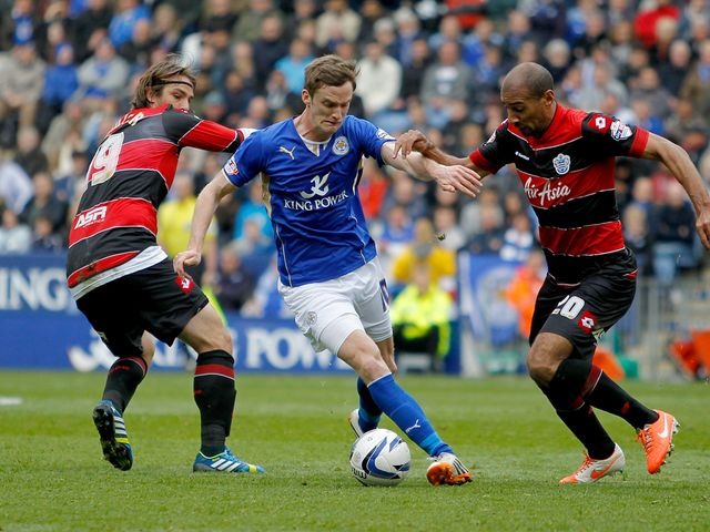 Leicester City's Andy King (centre) battles for the ball with Queens Park Rangers' Niko Kranjaer and Karl Henry