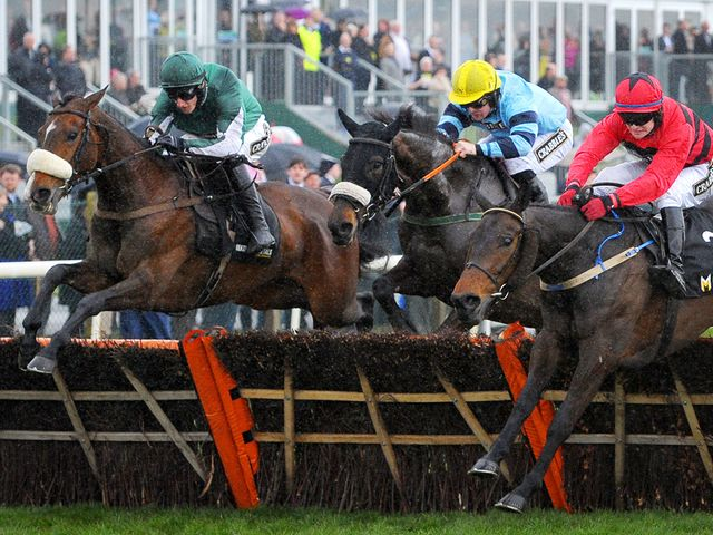 Court Minstrel, ridden by Adam Wedge (left), swoops late to score at Aintree