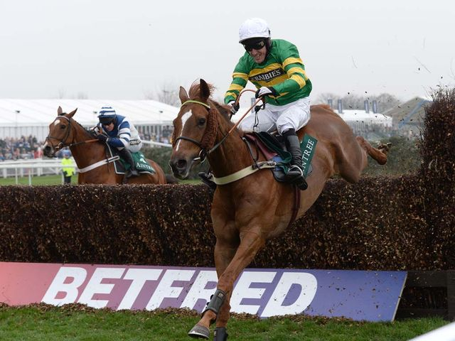 Uxizandre and Tony McCoy lead Oscar Whisky over the final fence
