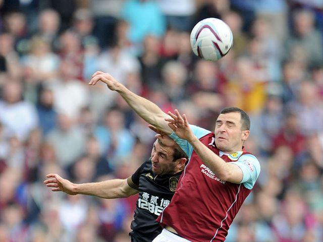 Burnley's Dean Marney (right) and Wigan's James McArthur contest a header