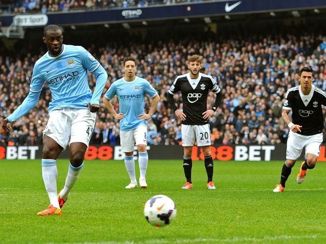 Yaya Toure scores Man City's opening goal from the penalty spot