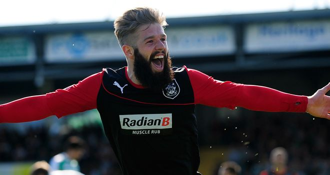Adam Clayton celebrates Huddersfield's winner